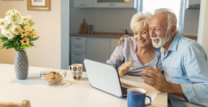 Older couple using a laptop
