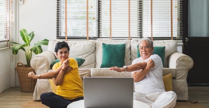 Asian old senior couple exercise doing yoga at home