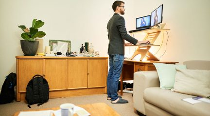 Man using a standing desk to work
